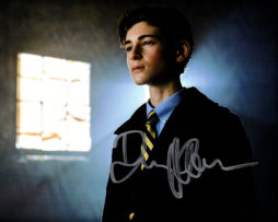 David Mazouz SIGNED photo: Bruce Wayne standing by a window