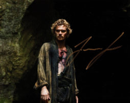 Finn Jones SIGNED photo: Iron Fist Danny in a cave